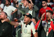 England supporters watch as Harry Kane takes a penalty and scores their second goal against Denmark