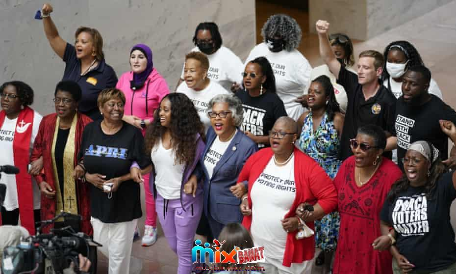 Congresswoman Joyce Beatty, center, chair of the Congressional Black Caucus, and other activists lead a peaceful demonstration to advocate for voting rights in the Hart Senate Office Building in Washington on Thursday.