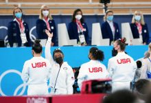 Simone Biles of the United States waved to the sparse crowd as athletes from eight countries were introduced.